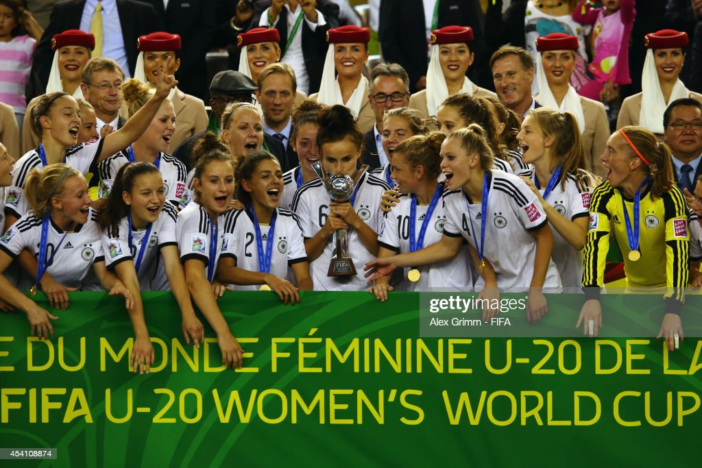 Team captain Lina Magull lifts the World Cup trophy and celebrates with team mates after winning the FIFA U-20 Women's World Cup Canada 2014 final match between Nigeria and Germany at Olympic Stadium on August 24, 2014 in Montreal, Canada.