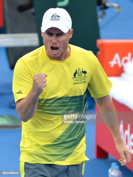 Team Captain Lleyton Hewitt of Australia celebrates after Jordan Thompson wins a break point in his match against Jack Sock of the USA during the...