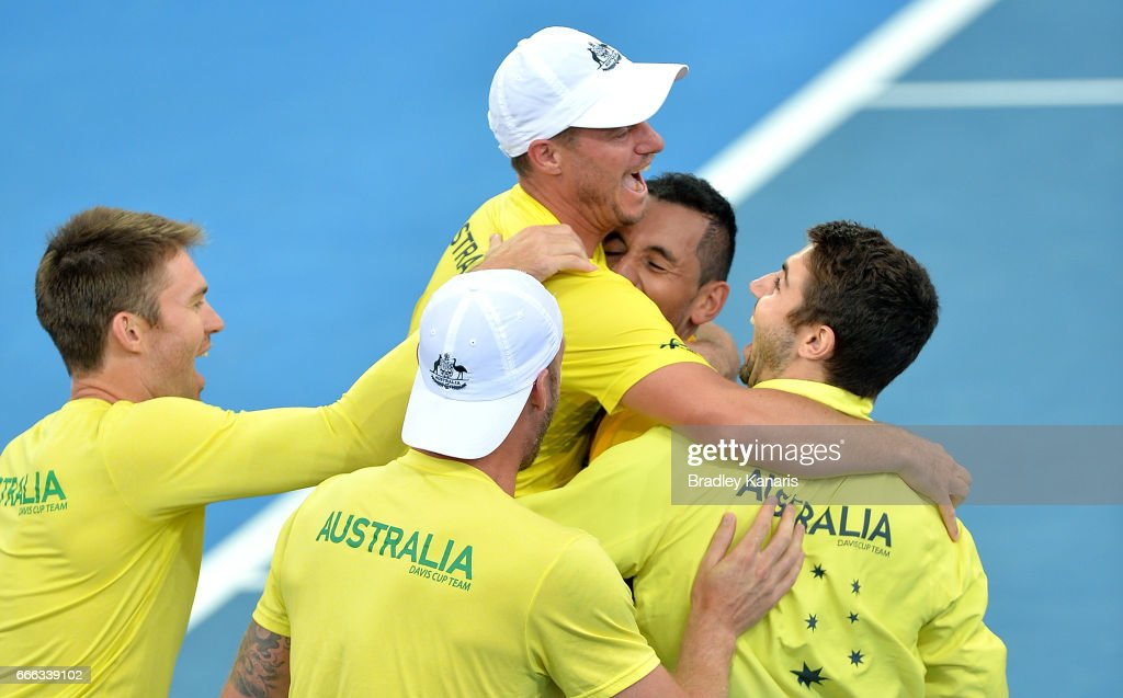 Team Captain Lleyton Hewitt of Australia celebrates victory with his team of Nick Kyrgios, Sam Groth, Jordan Thompson and Joh Peers after the match between Nick Kyrgios of Australia and Sam Querrey of the USA at the Davis Cup World Group Quarterfinals between Australia and the USA at Pat Rafter Arena on April 9, 2017 in Brisbane, Australia.