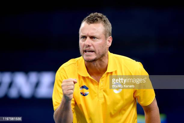 Team Captain Lleyton Hewitt of Australia cheers on team mate Alex de Minaur in the match against Denis Shapovalov of Canada during day three of the...