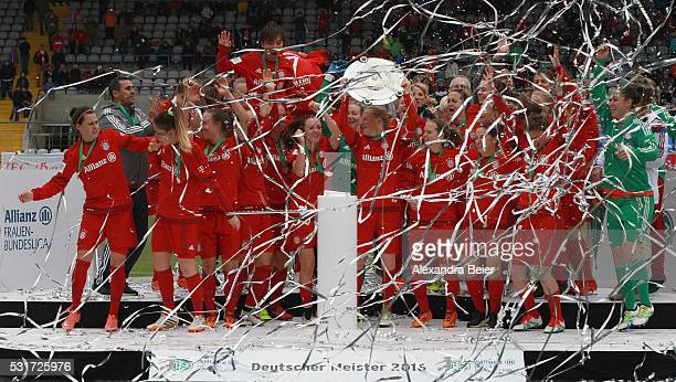Team captain Melanie Behringer and her teammates of Bayern Muenchen celebrate the German Championship title after the women Bundesliga match between...