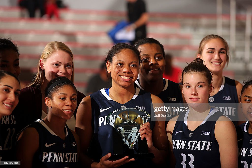 Team captain Mia Nickson #24 of the Penn State Lady Lions smiles as she holds the 2012 Radisson Hotel Tournament Classic Champions trophy while posing with teammates (back row, l-r) Ariel Edwards #23, Marisa Wolfe #40, Talia East #5, Tori Waldner #44, (front row, l-r) Gizelle Studevent #25, Dara Taylor #2, Maggie Lucas #33 and Alex Bentley #20 after the game against the Northridge Matadors at The Matadome on November 24, 2012 in Northridge, California. Penn State won 85-73.