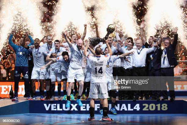 Team captain Michael Guigou of Montpellier lifts the trophy after his team won the EHF Champions League Final 4 Final match between Nantes HBC and...