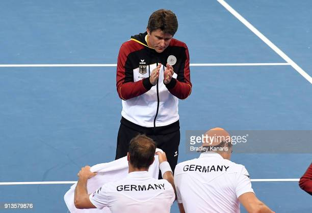 Team Captain Michael Kohlmann of Germany encourages Jan-Lennard Struff and Tim Putz in the doubles match against Matt Ebden and John Peers of...