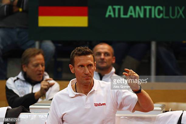 Team captain Patrick Kuehnen of Germany reacts during the doubles match between Tommy Haas and Philipp Petzschner of Germany and David Nalbandian and...