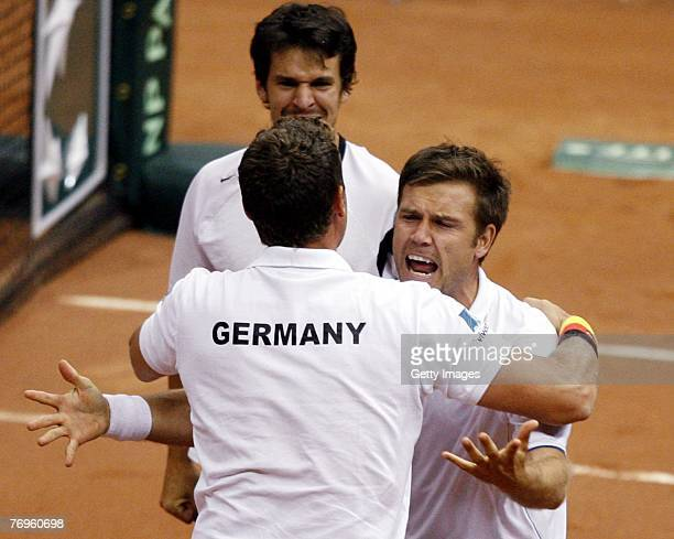 Team Captain Patrik Kuhnen Alexander Waske and Philipp Petzscher of Germany celebrate their victory over Dmitry Tursunov and Mikhail Youzhny of...
