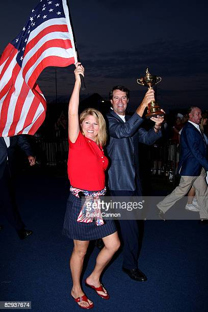 USA team captain Paul Azinger and his wife Toni celebrate with the Ryder Cup after his team's 16 1/211 1/2 victory on the final day of the 2008 Ryder...