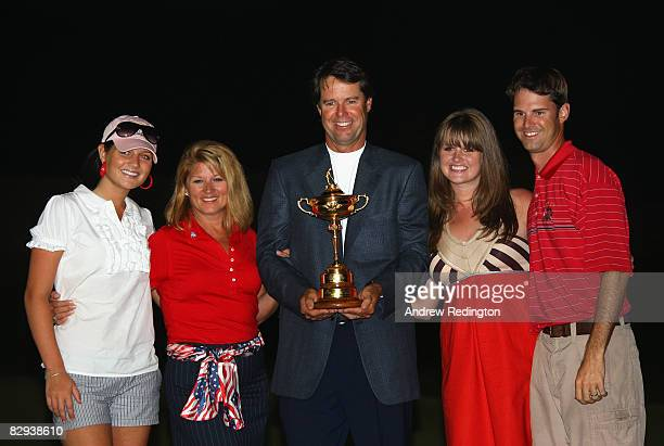 USA team captain Paul Azinger poses with his wife Toni and their children with the Ryder Cup after his team's 16 1/211 1/2 victory on the final day...