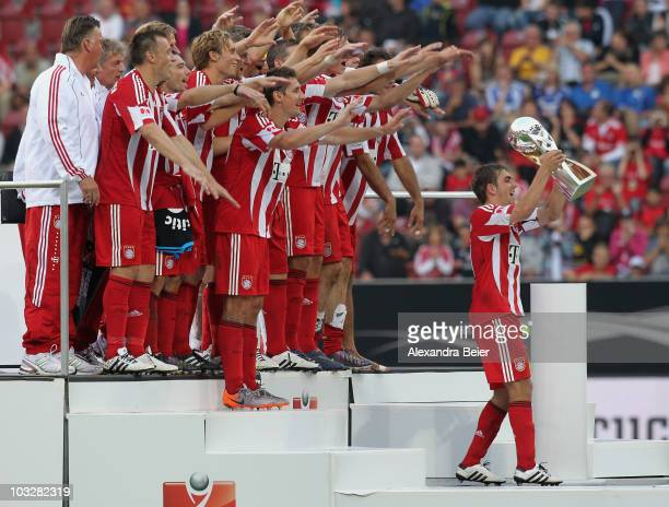 Team captain Philipp Lahm and his team of Bayern Muenchen celebrate with the Supercup trophy after the Supercup match between FC Bayern Muenchen and...