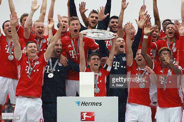 Team captain Philipp Lahm and the team of Bayern Muenchen celebrates with the German Championship trophy after the Bundesliga match between FC Bayern...