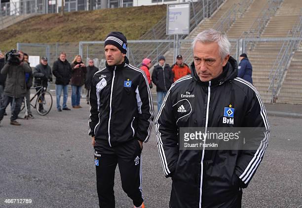 Team captain Rafael van der Vaart walks with Bert van Marwijk head coach of Hamburg during the training session of Hamburger SV on February 3 2014 in...