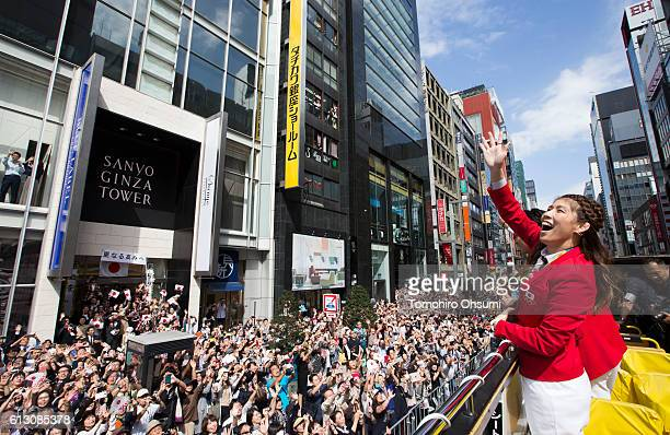Team captain Saori Yoshida waves from the top of a double decker bus during the Rio Olympics 2016 Japanese medalist parade in the ginza district on...