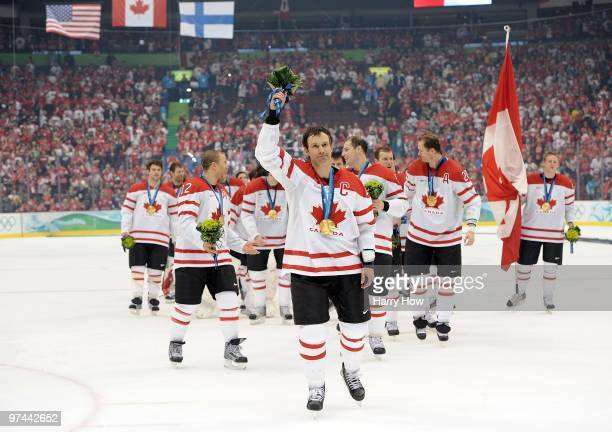 Team Captain Scott Niedermayer of Canada waves to the fans after receiving the gold medal following his team's 32 overtime victory in the ice hockey...