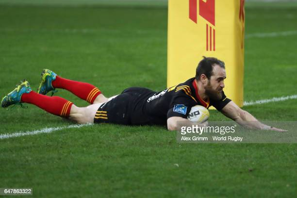 Team captain Sean Armstrong of Germany touches down a try during the Rugby Europe Championship match between Germany and Belgium at...