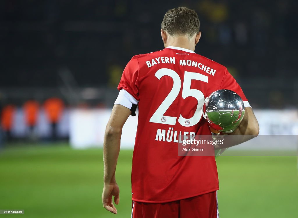 Team captain Thomas Mueller celebrates with the trophy after his team won the DFL Supercup 2017 match between Borussia Dortmund and Bayern Muenchen at Signal Iduna Park on August 5, 2017 in Dortmund, Germany.
