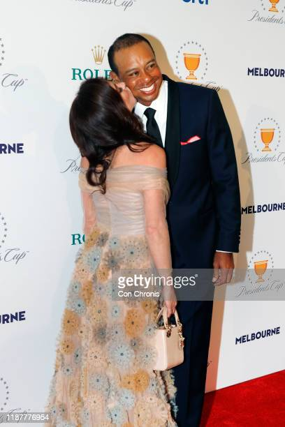 Team captain, Tiger Woods gets a kiss on the cheek from his girlfriend, Erica Herman, pose on the red carpet during the Presidents Cup Gala prior to...