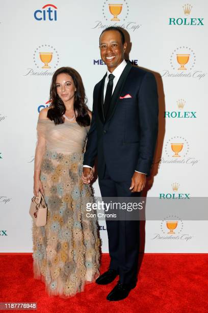 Team captain, Tiger Woods with his girlfriend, Erica Herman, pose on the red carpet during the Presidents Cup Gala prior to Presidents Cup at The...