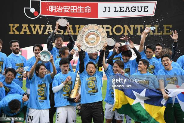 Team captain Yu Kobayashi of Kawasaki Frontale lifts the JLeague Champions Schale as they celebrate the J1 Season Champions after the JLeague J1...