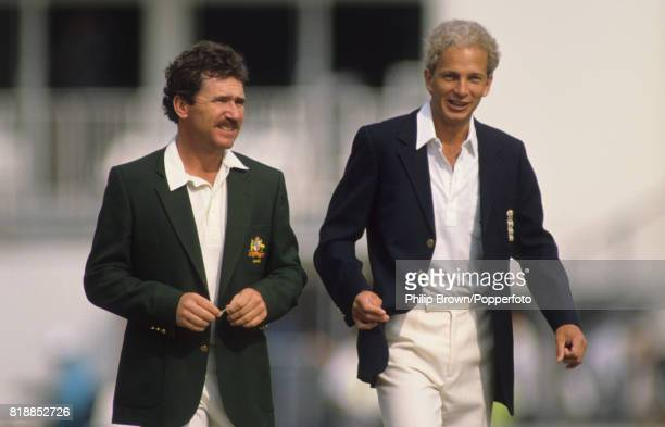Team captains Allan Border of Australia and David Gower of England walk back to the pavilion after the coin toss before the 6th Test match between...