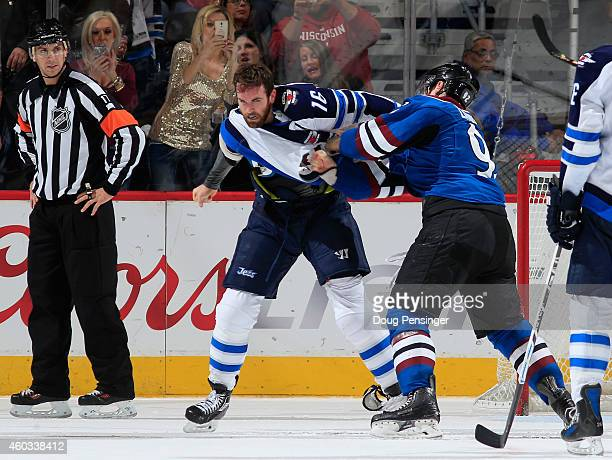 Team captains Andrew Ladd of the Winnipeg Jets and Gabriel Landeskog of the Colorado Avalanche engage in a fight resulting in penalties in the second...
