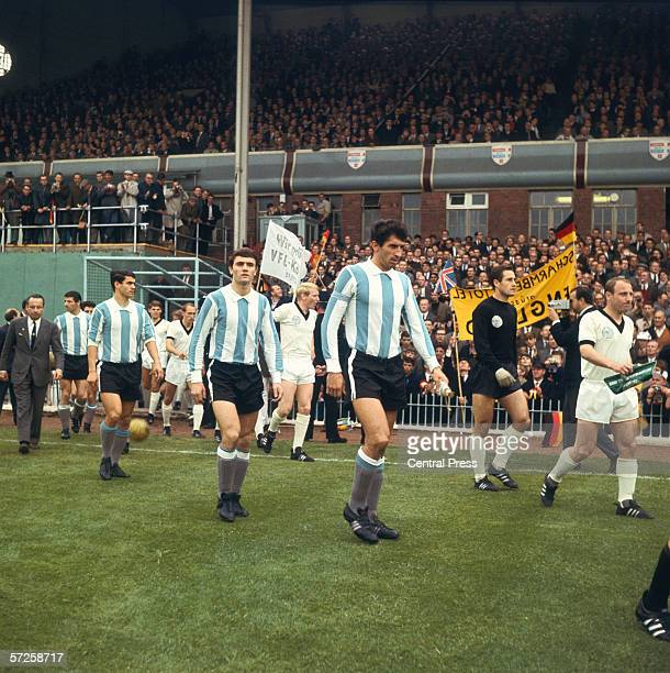 Team captains Antonio Rattin and Uwe Seeler leading out Argentina and West Germany at Villa Park for their Group B match during the 1966 World Cup in...