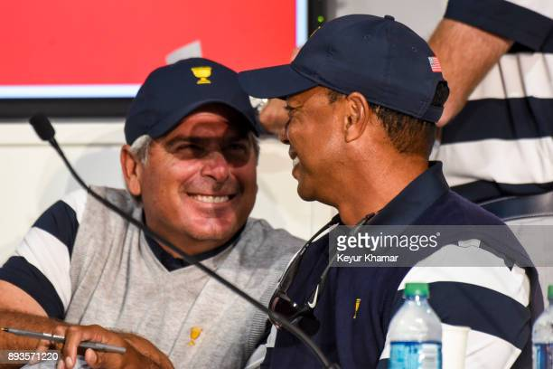 US Team Captain's Assistants Fred Couples and Tiger Woods share a laugh while deciding pairings following Thursday Foursomes on the first day of the...