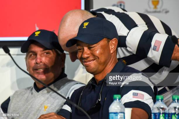 US Team Captain's Assistants Fred Couples Jim Furyk and Tiger Woods share a laugh while deciding pairings following Thursday Foursomes on the first...