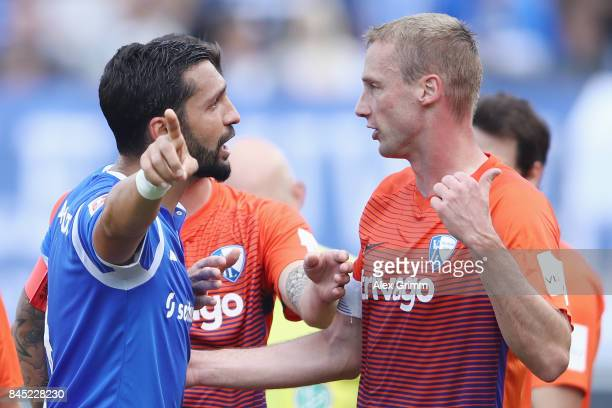 Team captains Aytac Sulu of Darmstadt and Felix Bastians of Bochum discuss during the Second Bundesliga match between SV Darmstadt 98 and VfL Bochum...