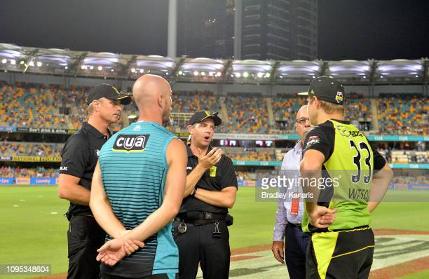 Team captains Chris Lynn of the Heat and Shane Watson of the Thunder are told by officials that the match is to be abandoned after the power in a...