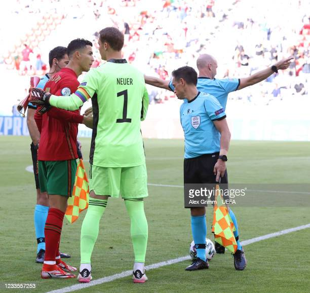 Team captains Cristiano Ronaldo of Portugal and Manuel Neuer of Germany shake hands prior to the UEFA Euro 2020 Championship Group F match between...