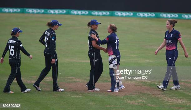 Team captains Danielle Hazell of England and Suzie Bates of New Zealand shake hands at the end of the ICC Women's World Cup warm up match between...