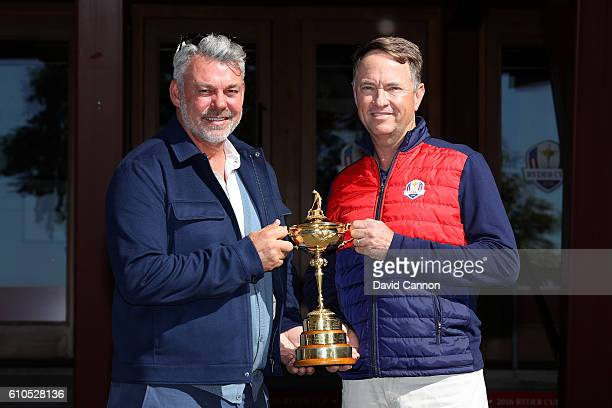 Team captains Darren Clarke and Davis Love III pose with the Ryder Cup Trophy prior to the 2016 Ryder Cup at Hazeltine National Golf Club on...