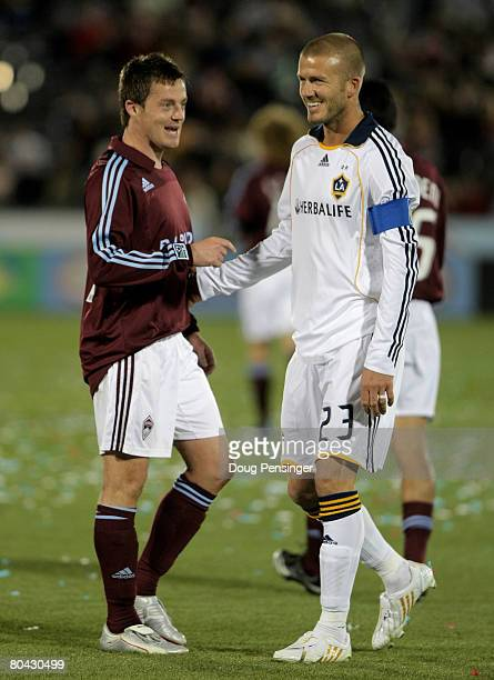 Team captains David Beckham of the Los Angeles Galaxy and Terry Cooke of the Colorado Rapids chat during a break in the action at Dick's Sporting...