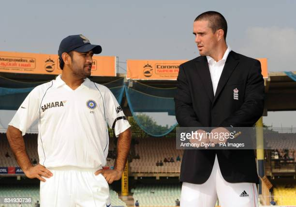 Team captains MS Dhoni and Kevin Pietersen speak before the toss during the First Test Match at the M A Chidambaram Stadium in Chennai India