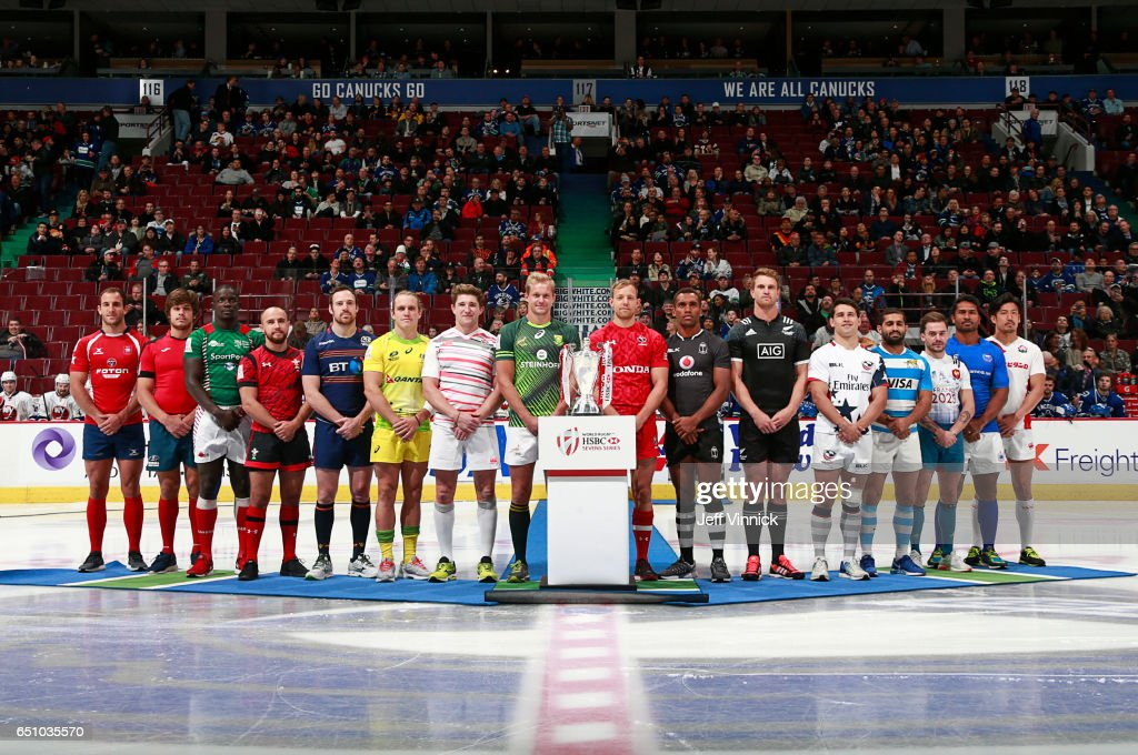 Team captains from the World Rugby Sevens Series pose with the tournament trophy before the NHL game between the Vancouver Canucks and the New York Islanders at Rogers Arena March 9, 2017 in Vancouver, British Columbia, Canada.