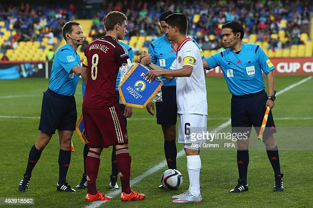 Team captains Georgy Makhatadze of Russia and Luis Hernandez of Costa Rica shake hands prior to the FIFA U17 World Cup Chile 2015 Group E match...