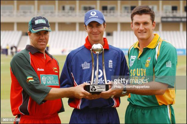 Team captains Heath Streak of Zimbabwe, Michael Vaughan of England and Graeme Smith of South Africa stand with the trophy at the launch of the...