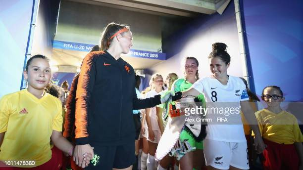 Team captains Lize Kop of Netherlands and Malia Steinmetz of New Zealand shake hands in the tunnel prior to the FIFA U-20 Women's World Cup France...