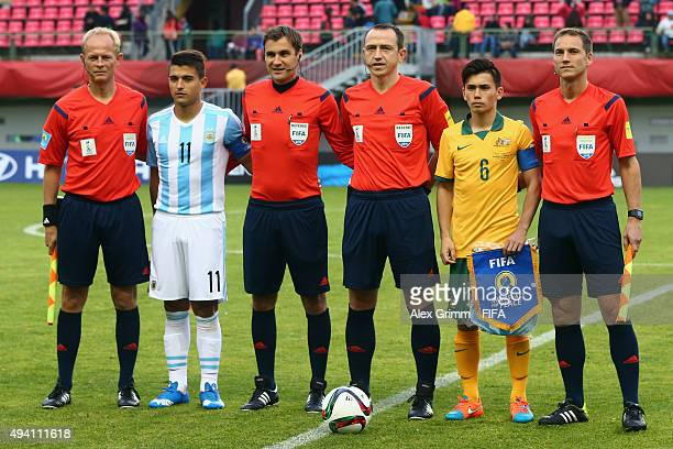 Team captains Lucas Ferraz Vila of Argentina and Joe Caletti of Australia pose with the match officials prior to the FIFA U17 World Cup Chile 2015...