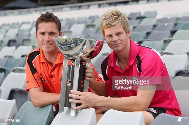 Team captains Marcus North of the Perth Scorchers and Steve Smith of the Sydney Sixers pose with the T20 trophy during the Big Bash League Final...