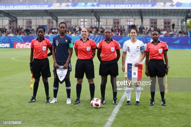 Team captains MarieAntoinette Katoto of France and Malia Steinmetz of New Zealand pose with the match officials prior to the FIFA U20 Women's World...