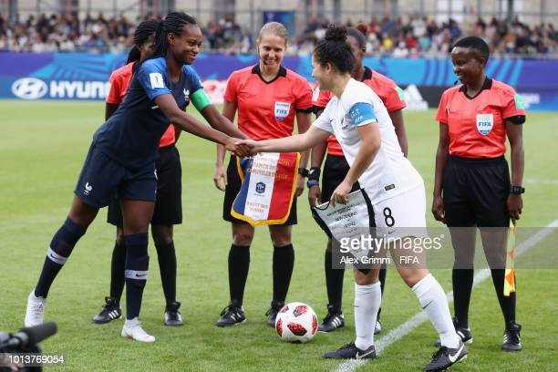 Team captains MarieAntoinette Katoto of France and Malia Steinmetz of New Zealand shake hands prior to the FIFA U20 Women's World Cup France 2018...
