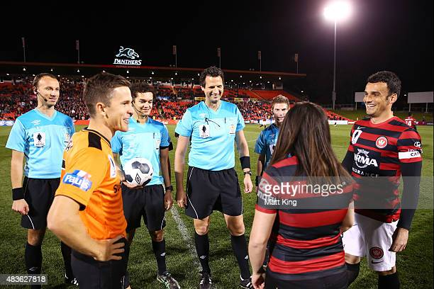 Team captains Matt McKay of the Roar and Mark Bridge of the Wanderers take part in the coin toss during the FFA Cup match between Western Sydney...