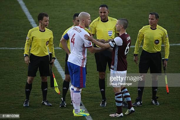 Team captains Michael Bradley of Toronto FC and Sam Cronin of Colorado Rapids meet with the referees at Dick's Sporting Goods Park on April 2 2016 in...