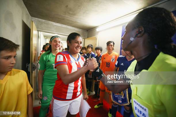 Team captains Moeka Minami of Japan and Lorena Alonso of Paraguay wait in the tunnel prior to the FIFA U20 Women's World Cup France 2018 group C...