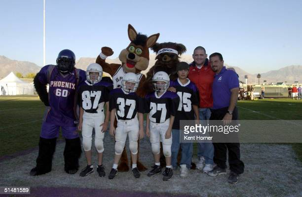 Team captains of the Mascots Phoenix Suns Gorilla San Antonio Spurs Coyote Utah Jazz Bear and Olympic wrestling medalist Rulan Garner pose with...