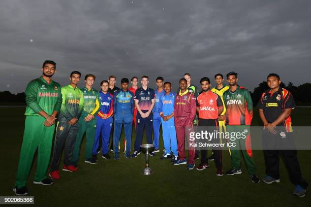 Team captains pose with the ICC World Cup trophy during the ICC U19 Cricket World Cup Opening Ceremony on January 7 2018 in Christchurch New Zealand