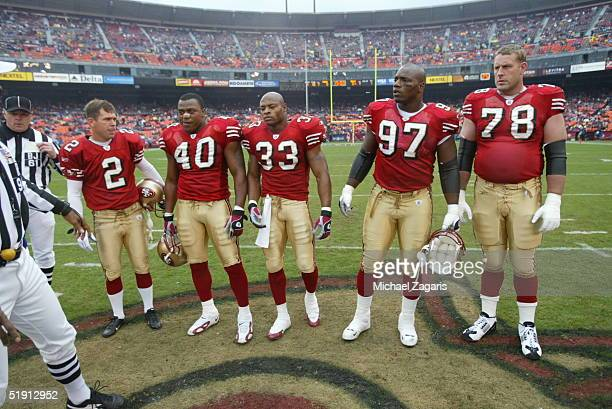Team captains Scott Gragg Bryant Young Tony Parrish Todd Peterson and Fred Beasley of the San Francisco 49ers before the game against the Buffalo...