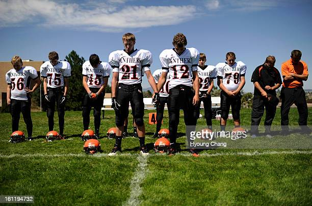 Team captains Tyler Ernst Sean Vanous and coaches and teammates of Flagler High School football team are in the moment of silence for their teammate...