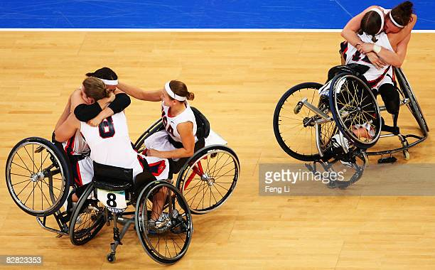 Team celebrates after winning the Gold in the Wheelchair Basketball match between USA and Germany at the National Indoor Stadium during day eight of...